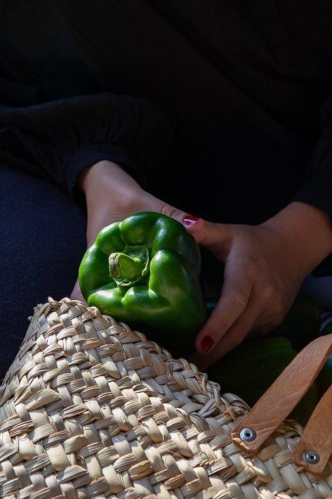 poivron dans une main